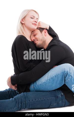 Bella giovane azienda ogni altro con affetto e passione isolati su sfondo bianco Foto Stock