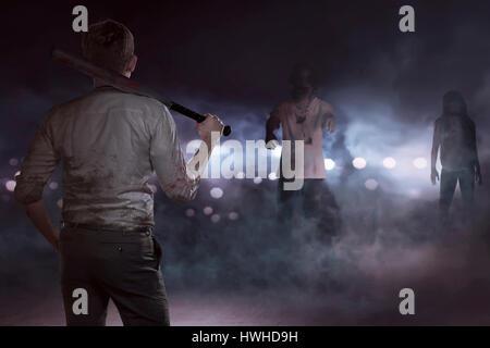 Imprenditore aggressivo vedendo zombie con una mazza da baseball nella notte nebbiosa Foto Stock