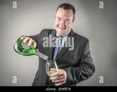 Imprenditore di bere alcool Foto Stock