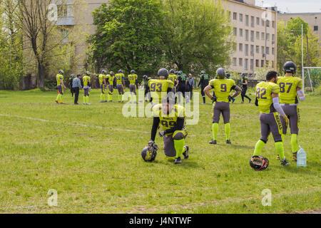 American Football team durante una pausa nel gioco Foto Stock