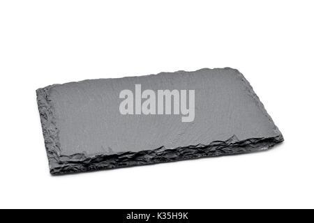 Un pezzo rettangolare di pietra ardesia su sfondo bianco Foto Stock