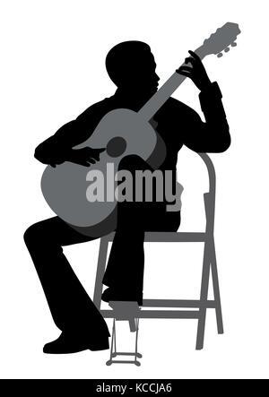 Giovane uomo suonare la chitarra acustica Foto Stock