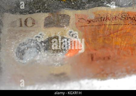 Nuovo £10 nota congelate in ghiaccio Foto Stock