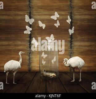 Fantasy composizione artistica con una lepre in un vasetto di vetro, farfalle e due struzzo bianco Foto Stock