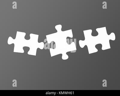 Puzzle di pezzi isolati contro uno sfondo grigio Foto Stock