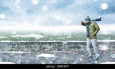 Pedone in una tempesta di neve Foto Stock