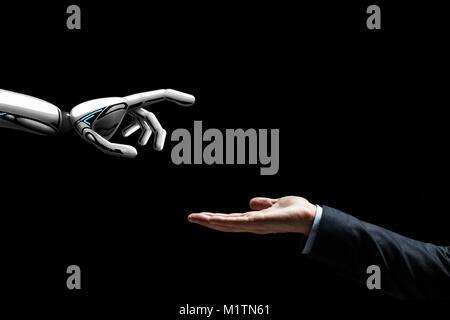 Il robot e la mano umana su sfondo nero Foto Stock