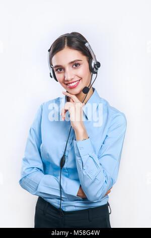 La donna di servizio del cliente lavoratore, call center operatore sorridente con auricolare del telefono Foto Stock