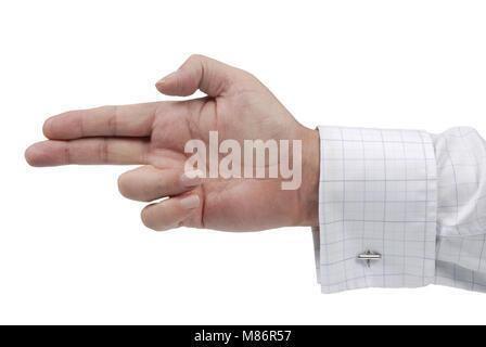 Executive maschio tenendo la mano di puntamento o le sue dita a forma di pistola isolato su uno sfondo bianco. Foto Stock