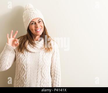 ... di lana · Medioevo donna che indossa la lana Cappello invernale facendo  segno ok con le dita 08eecad8521e