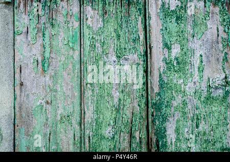 ... Il legno vecchio texture di sfondo. Vintage verniciato di verde lo  sfondo da una verticale ae768b1750de