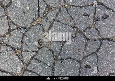 Spaccature sugli asfalti del pattern di sfondo texture Foto Stock