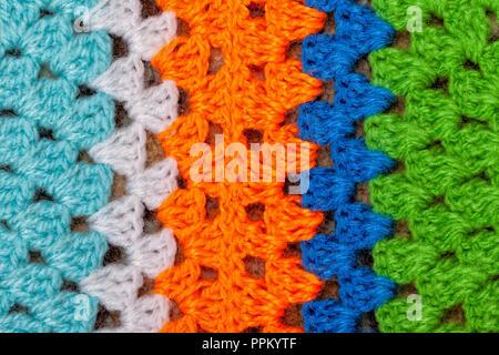 Un Crochet Fatti A Mano Coperta Di Lana Sfondo Foto Immagine Stock
