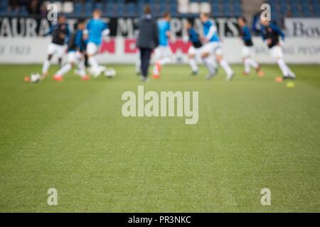 Una squadra di calcio si appresta a giocare una partita. Foto Stock