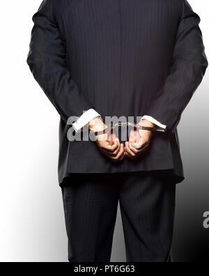Concetto Business Wall Street Uomo con tuta con manette, White Collar Crime Foto Stock