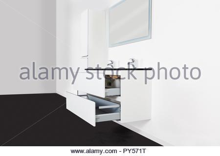 Studio riprese di un set completo di mobili per bagno contro uno