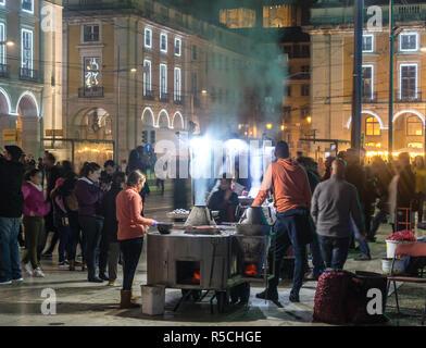 I venditori di dadi, in Piazza del commercio a Lisbona