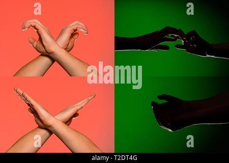 Un set di caratteri sulle dita di mani umane che sono rappresentate da sagome isolato su un sfondo verde 2019 Foto Stock