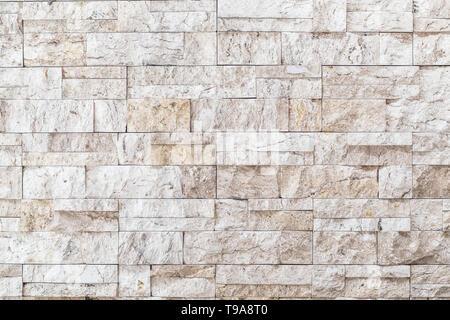 In bianco e nero un muro di mattoni arte calcestruzzo o pietra texture di sfondo bianco Foto Stock