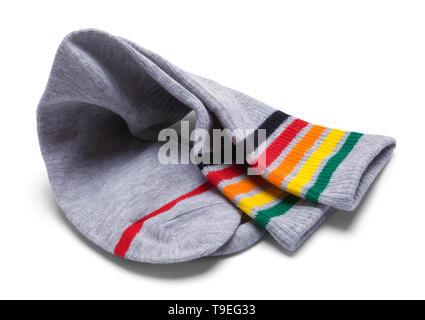 Due strisce di colore grigio calze ripiegate su isolati su bianco. Foto Stock