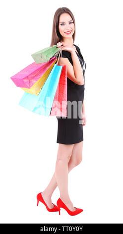 Bella giovane donna azienda shopping bags isolato su bianco Foto Stock