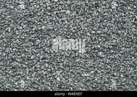 Grigio pietra dello sfondo. Configurazione astratta di ghiaia. Strada naturale texture. Materiale di roccia. Grunge pavimento su strada.