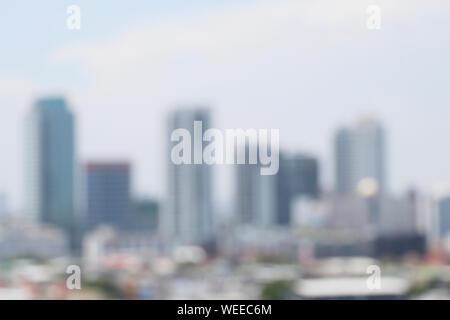 Abstract sfocate con vista offuscata della città sullo sfondo. Foto Stock