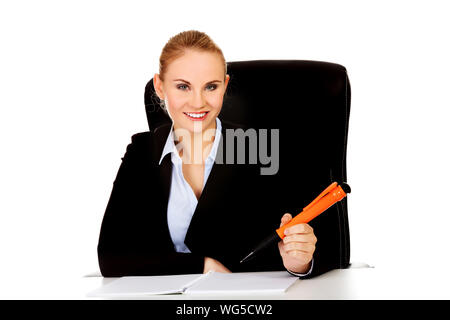 Businesswoman with high heels on desk Stock Photo: 96362085