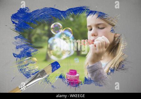 Immagine composita della bambina a soffiare bolle con pennello immerso nel blu contro generati digitalmente uno sfondo grigio Foto Stock