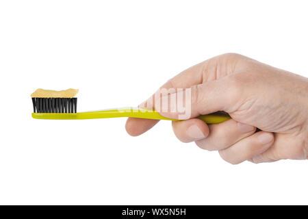 Mano con spazzolino da denti Foto Stock