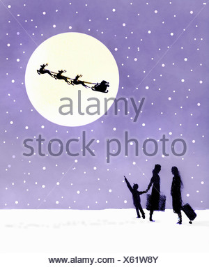 Bambino con sua madre cercando di silhouette di Babbo Natale e renne in luna piena Foto Stock