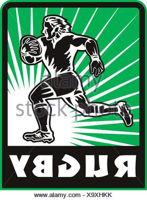 Rugby player executando bola Foto de Stock